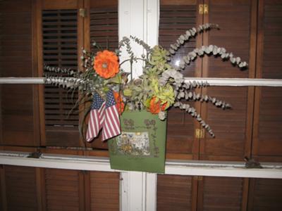 wren inside flower arrangement