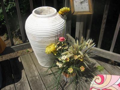 vase that wrens are nesting inside
